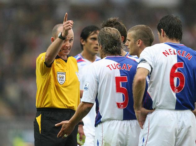 Blackburn Rovers' Tugay is warned by ref