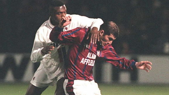 Bordeaux's Zinedine Zidane (R) struggles to keep M