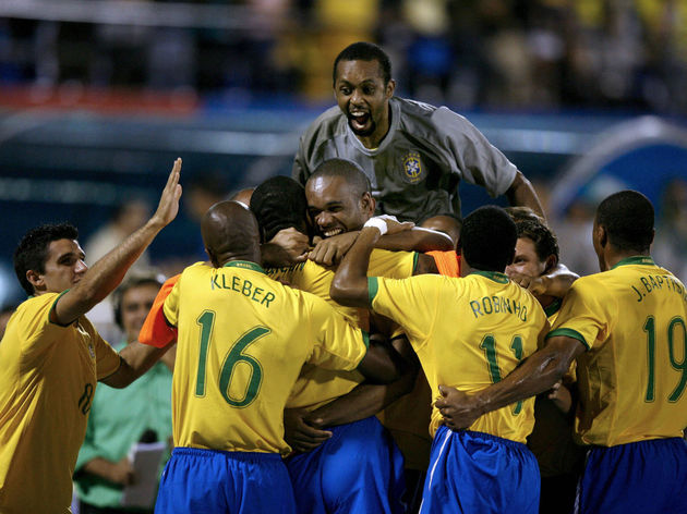 Brazil's footballers celebrate their fir...