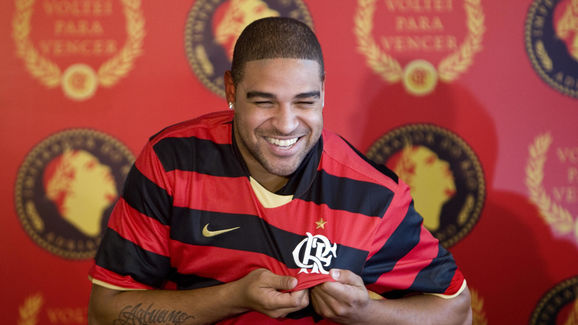Brazil's forward Adriano holds a Flameng