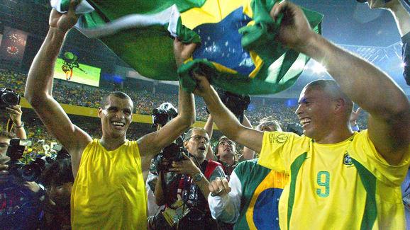Brazil's forward Ronaldo (R) and midfielder Rivald