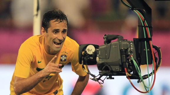 Brazil's Jonas Oliviera talks into a TV
