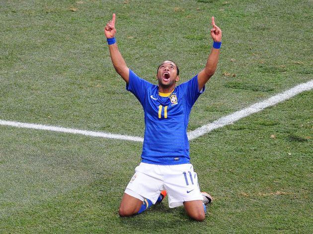 Brazil's striker Robinho celebrates afte
