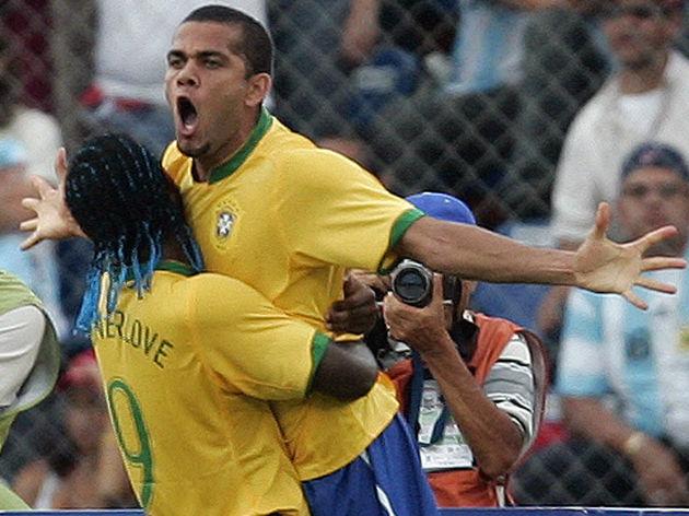 Brazilian defender Daniel Alves (up) cel...