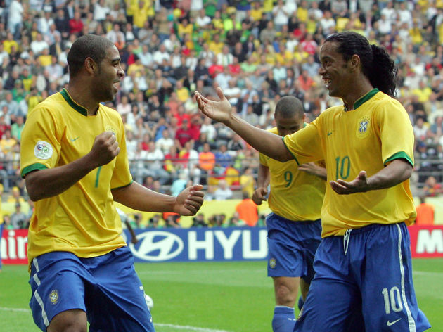Brazilian forward Adriano (L) celebratin