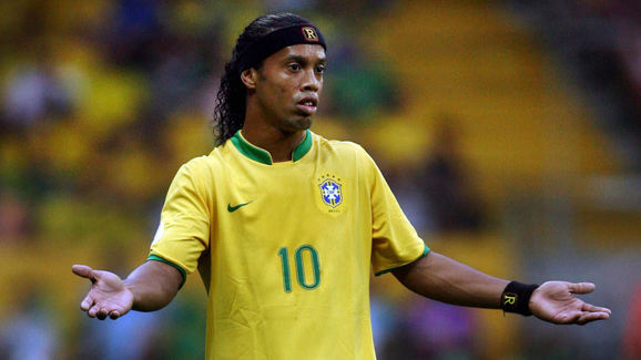 Brazilian midfielder Ronaldinho reacts a