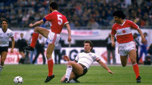 Bryan Robson of England and Ongi Erhan of Turkey