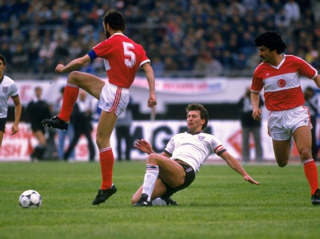 Bryan Robson of England and Ongi Erhan of Turkey