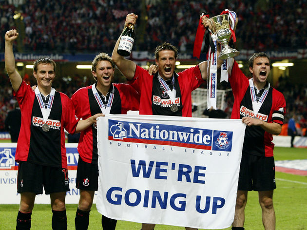 Carl Fletcher, Steve Fletcher, Stephen Purches and Gareth O'Connor of Bournemouth celebrate