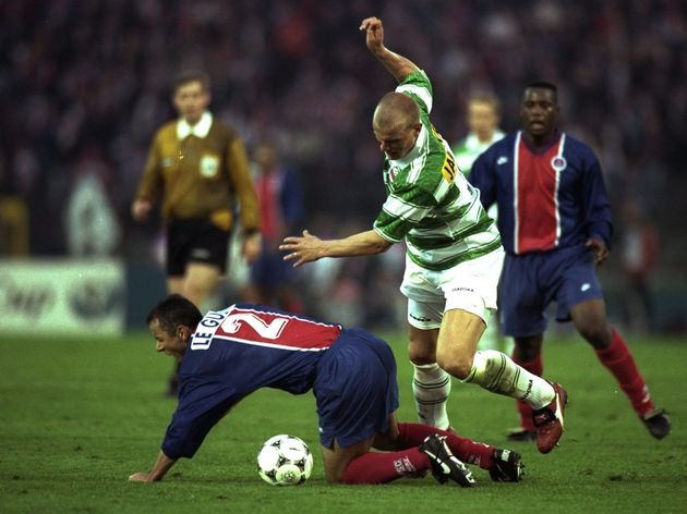 Carsten Jancker of Vienna falls over Paul Le Guen of Saint-Germain