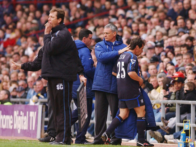 Chelsea manager Claudio Ranieri consoles Gianfranco Zola after being substituted,