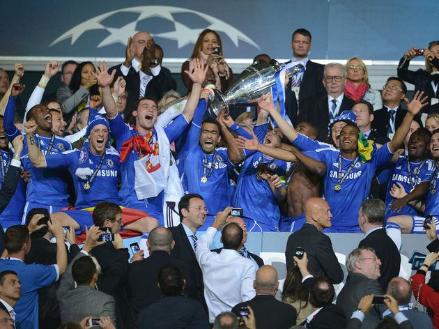 Chelsea players celebrate with the troph