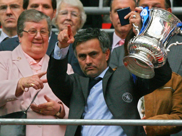 Chelsea's manager Jose Mourinho lifts th...