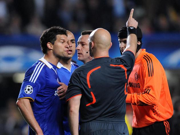 Chelsea's Michael Ballack (L) argues wit