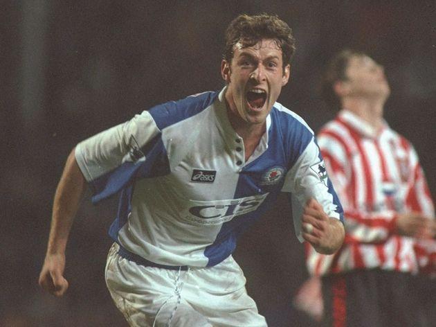 Chris Sutton of Blackburn turns to celebrate scoring