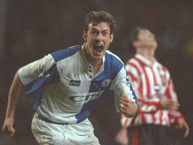 Chris Sutton of Blackburn turns to celebrate scoring