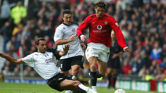Cristiano Ronaldo of United gets past Sylvain Legwinski of Fulham