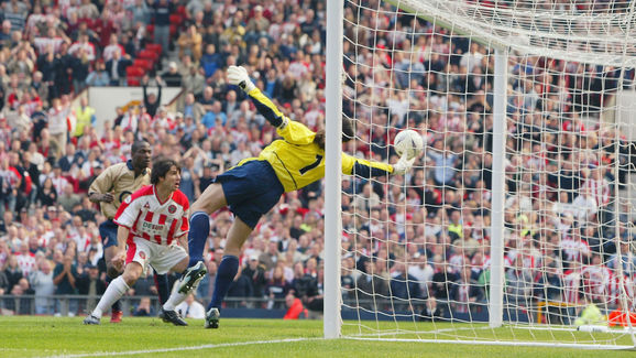 David Seaman of Arsenal makes a spectacular save to keep the ball out