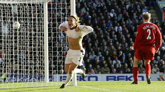 Diego Forlan of Manchester United celebrates scoring the first goal of the match