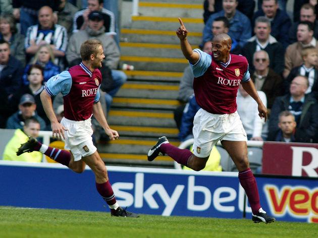 Dion Dublin of Aston Villa celebrates scoring the equalising goal with team-mate Olof Mellberg