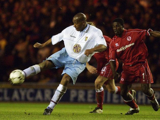 Dion Dublin of Aston Villa strikes the ball