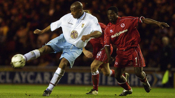 Dion Dublin of Aston Villa strikes the ball