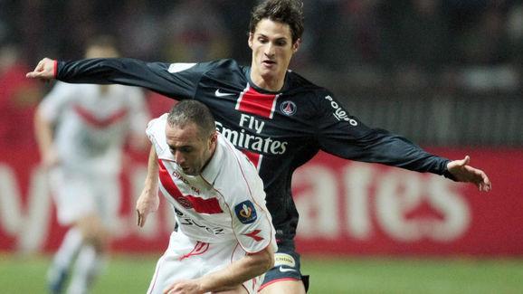 Valenciennes' Djamel Belmadi (L) vies wi
