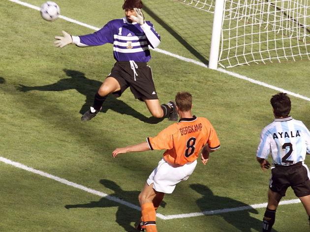 Dutch forward Dennis Bergkamp kicks the ball past