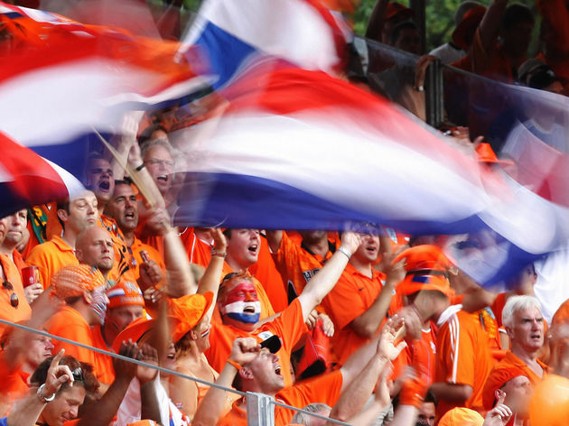 Dutch supporters wave national flags pri