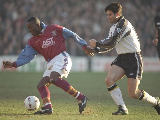 Dwight Yorke of Aston Villa (left) holds of Aljosa Asanovic of Derby