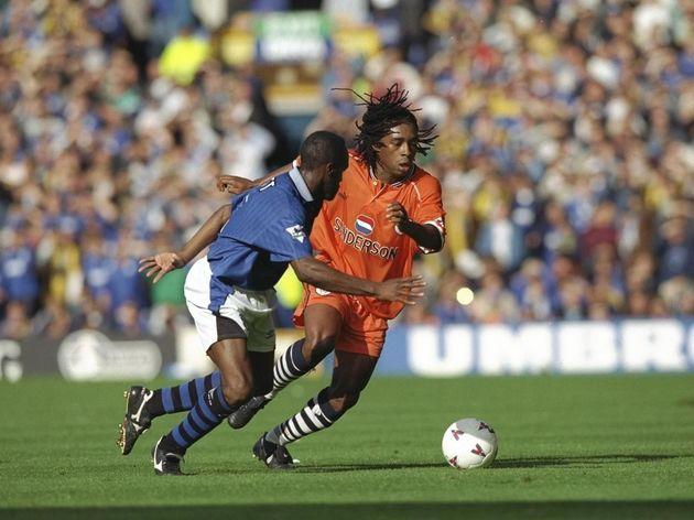 Earl Barrett of Everton (left) challenges Regi Blinker of Sheffield Wednesday