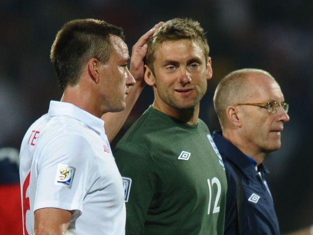 England's defender John Terry (L) comfor