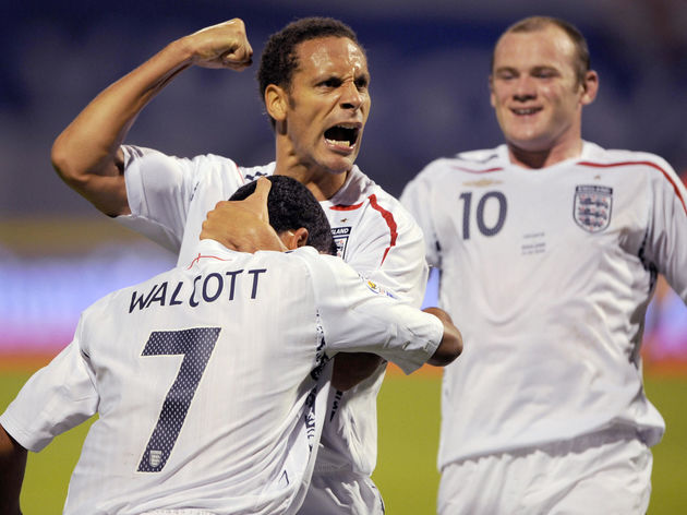 England's Rio Ferdinand and Wayne Rooney