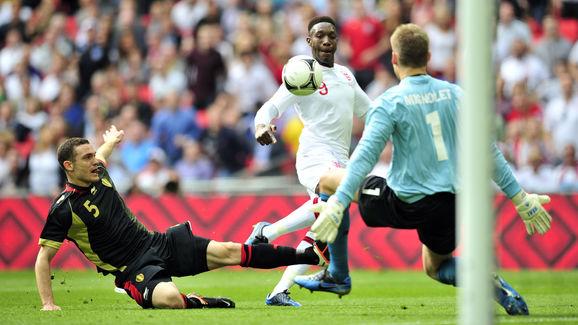England's striker Danny Welbeck (C) scor