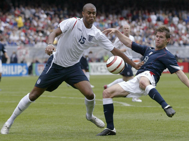England's Zat Knight (L) vies with Brian