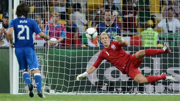 English goalkeeper Joe Hart (R) dives as