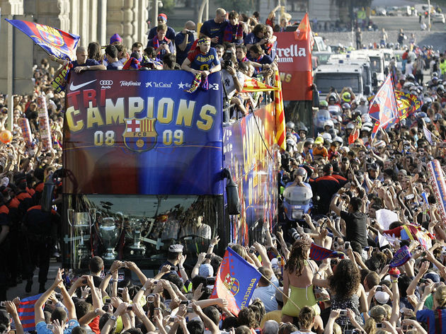 FC Barcelona fans wave to the soccer tea