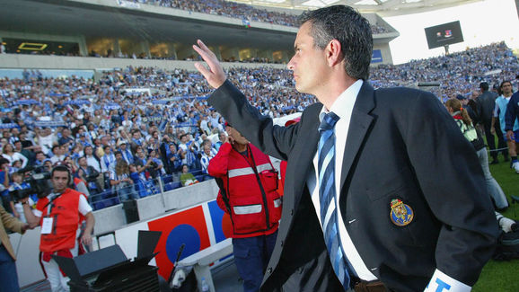FC Porto's coach Jose Mourinho salutes t