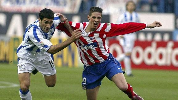 Fernando Sanz of Malaga and Fernando Torres of Atletico Madrid