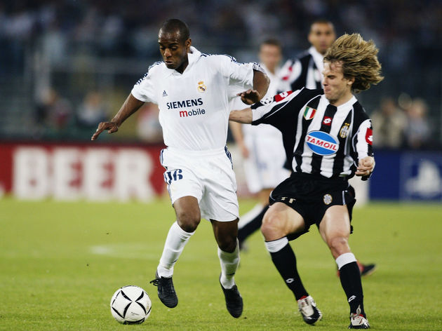 Flavio Conceicao of Real Madrid is tackled by Pavel Nedved of Juventus