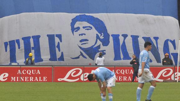 Football player trains past a giant bann ...