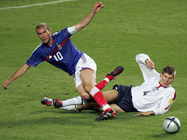 French captain Zinedine Zidane (L) is ta