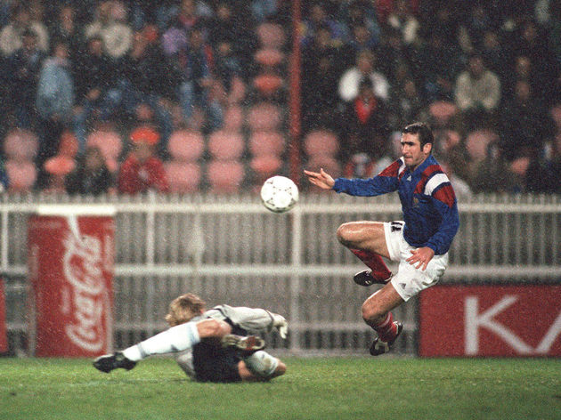 French striker Eric Cantona (C) scores t