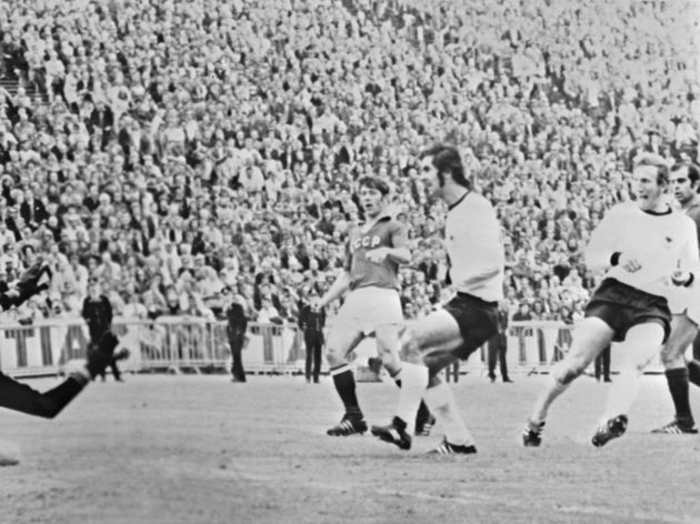 German midfielder Martin Wimmer (R) scores against the Soviet Union
