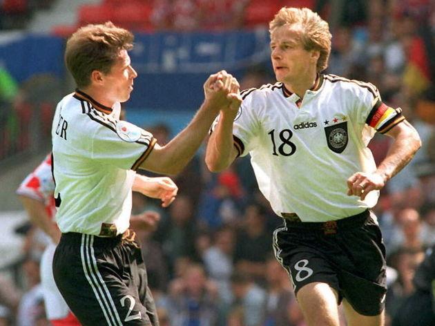 German player Stefan Reuter (L) congratulates capt
