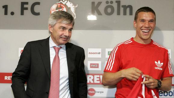 German striker Lukas Podolski (R) poses