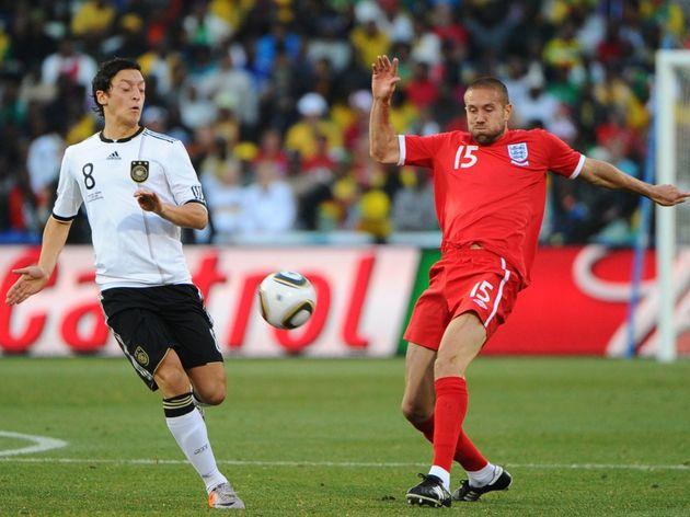 Germany's midfielder Mesut Ozil (L) vies