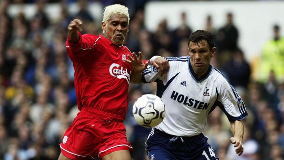Gustavo Poyet of Tottenham Hotspur and Abel Xavier of Liverpool
