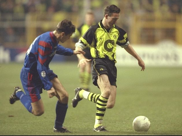 Ilie Iulian Miu of Steau (left) pursues Paul Lambert of Dortmund