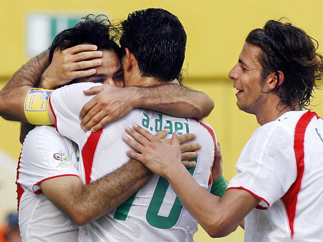 Iranian forward Ali Daei hugs Iranian de